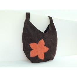 Bolso de tela redondo liso con flor